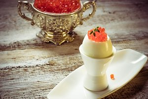 Egg with red salmon caviar