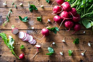 Radishes on rustic wood