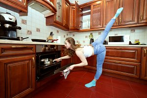 Sports woman in the kitchen.