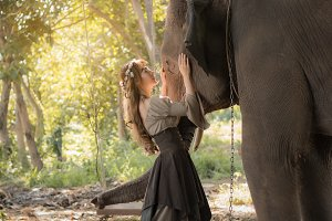 Beautiful Asian woman and elephant