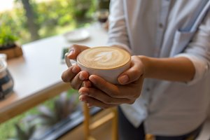 Woman hand holding coffee cup