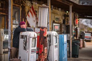 Young man at a vintage gas pump