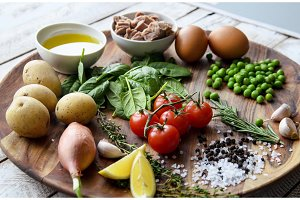Ingredients. Tuna salad with lettuce, eggs and tomatoes.