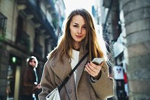 Student girl using smartphone by Evgeniia Kazarinova in Technology