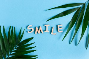 Word Smile made of wooden letters