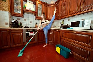 Gymnast washes the floors.