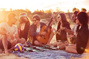 Young group of friends outdoors on the beach