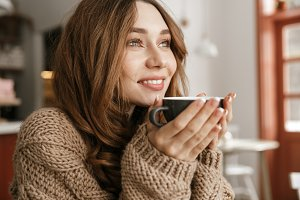 Happy woman with a cup of coffee