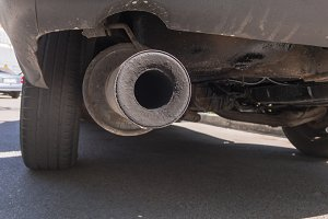 Dirty exhaust system of the old car