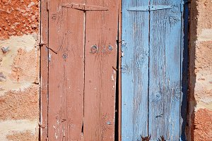 Old wooden door on Malia, Greece