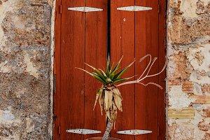 Old window on old town in Malia, Greece