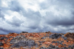 Landscape with rocks and cloudy sky