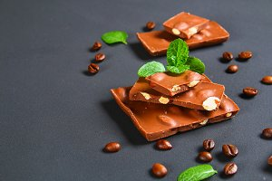 chocolate with almonds on dark grey background.