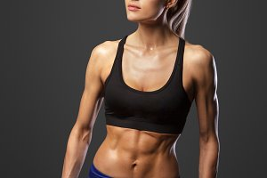 Sporty woman does the exercises with dumbbells