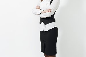 Full length beautiful caucasian young brown-hair business woman in black suit, white shirt crossed arms, looking camera isolated on white background. Manager or worker. Copy space for advertisement.
