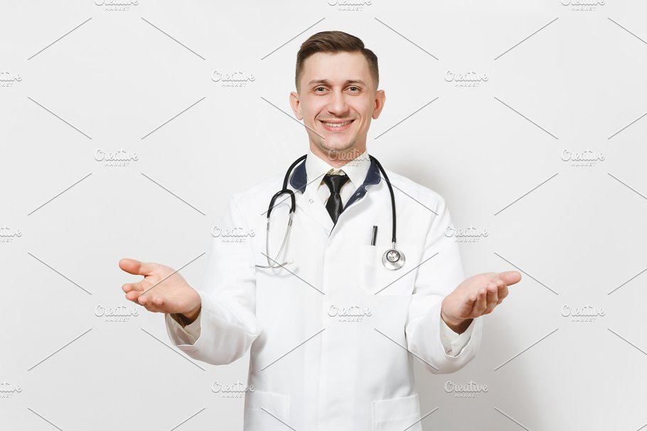 Smiling happy young doctor man isolated on white background. Male ...
