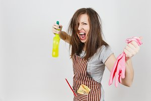 Young fun crazy loony wild screaming housewife tousled hair in apron squeegee rag in pocket isolated on white background. Mad woman shoot from spray bottle with cleaner liquid, pink gloves. Copy space