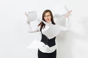 Shocked perplexed stress angry caucasian young business woman in black suit, white shirt, glasses throwing work documents isolated on white background. Manager or worker. Copy space for advertisement.