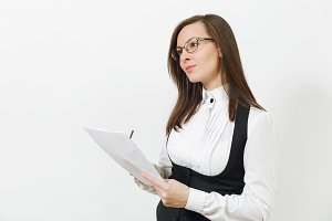 Beautiful serious caucasian young brown-hair business woman in black suit, white shirt, glasses with work paper documents isolated on white background. Manager or worker. Copy space for advertisement.