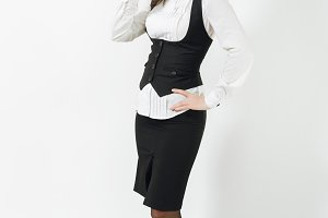 Full length portrait of beautiful caucasian young smiling brown-hair business woman in black suit, white shirt and glasses isolated on white background. Manager or worker. Copy space for advertisement