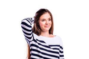 Girl in striped sweater, young beautiful woman, studio shot