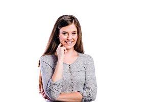 Girl in gray longsleved t-shirt young woman, studio shot