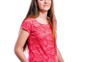 Girl in red t-shirt, young beautiful woman, studio shot