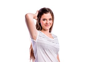 Girl in white t-shirt, young woman, studio shot