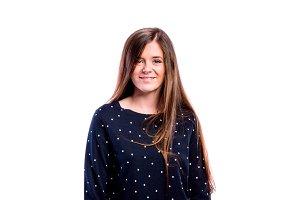 Girl in blue dotted sweatshirt young woman, studio shot