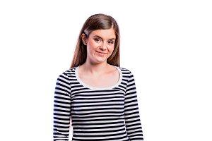 Girl in striped t-shirt, young beautiful woman, studio shot