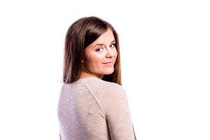 Girl in brown sweater, young woman, studio shot