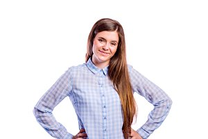 Girl in blue shirt, young beautiful woman, studio shot