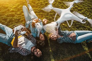 Group of friends broadcasting&#x3B; drone