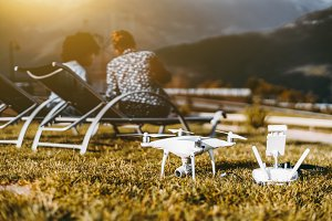 Drone on the grass and a couple