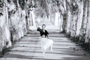 Young woman dancing contemporary flamenco on the street