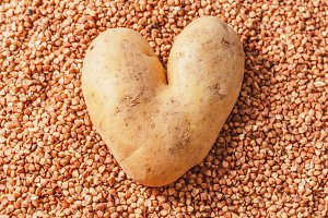 Heart-shaped potatoes on buckwheat