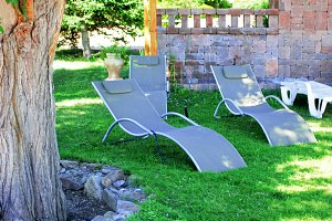 Grey fabric sun loungers