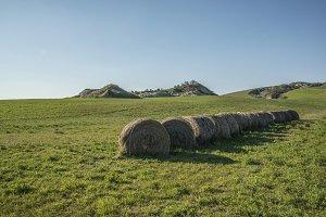Hay Bales in tuscan grassland hills