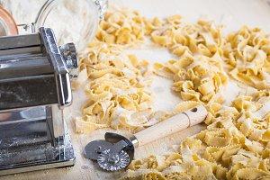 Fresh egg pasta and a dough cutter wheel