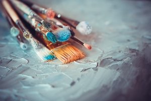 Paintbrushes on artist canvas