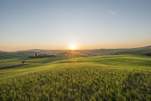 Sunset over idyllic Tuscany meadows