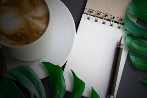 coffee cup and blank notebook