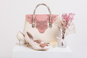 Female handbag, shoes and bouquet of dried flowers
