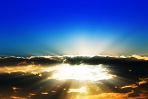 Sun rays through dramatic cloudscape background