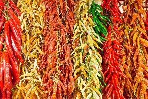Bunches of red and green peppers