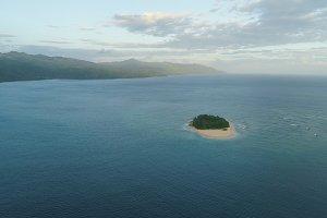Tropical island Rosa with sand beach.