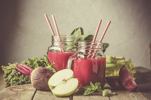 Alkaline diet concept - purple smoothies and ingredients