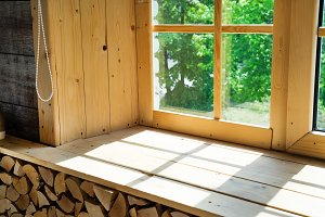 Empty room, wooden window with shadow is projected on the wooden sill