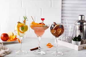 Different alcoholic drink in glass with Bar accessories on white wooden background