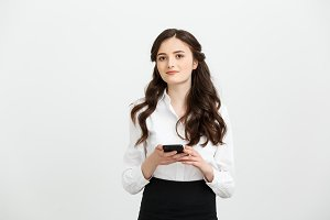Business Concept: Portrait of business woman using a mobile phone isolated on a white background